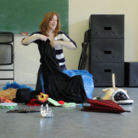 Jenna removing items from the character costume bin during a lesson at Daytime Moon Creations.